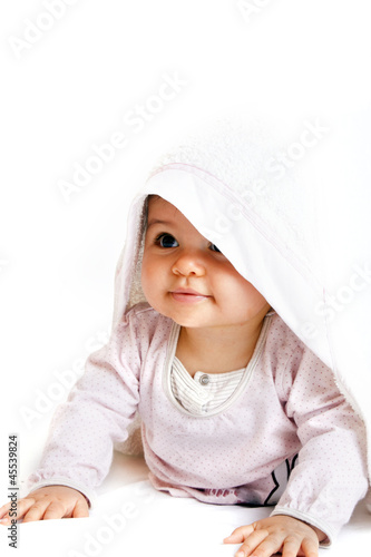 a little baby with a towel