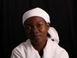Afrikanerin mit weißem Kopftuch