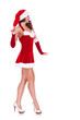 side view of a sexy young santa woman walking