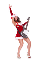 young santa woman playing a guitar