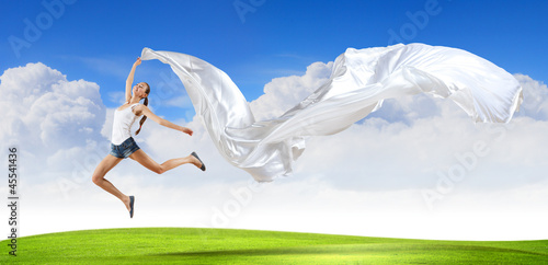 Modern style dancer against blue sky
