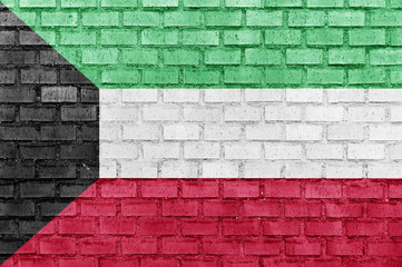 Kuwait flag on a brick wall