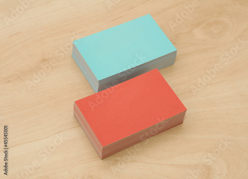 block of business cards on a wooden table