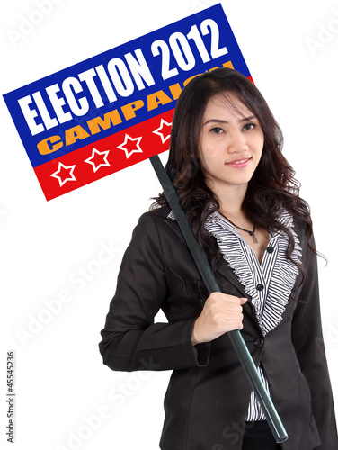 woman holding election sign