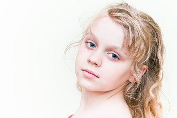 Little blond girl above white background
