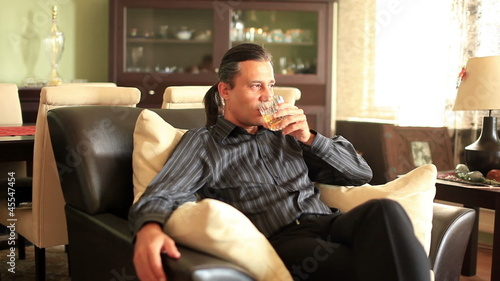alone man drinking alcohol  at home