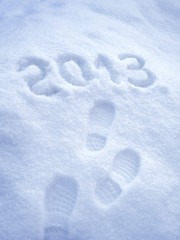 Foot step print in snow – New Year 2013 concept