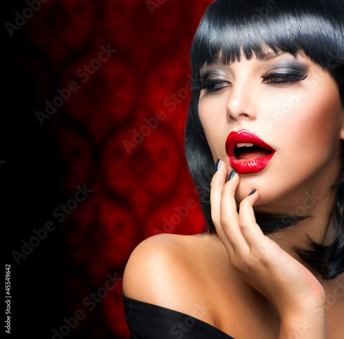 Beautiful Brunette Girl Portrait.Makeup. Sensual Red Lips
