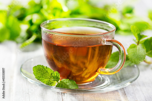 Fotobehang Thee cups of tea with mint