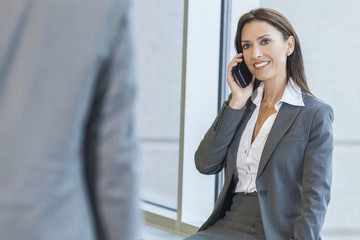 Woman or Businesswoman Using Cell Phone