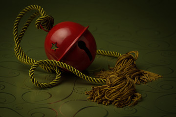 Red Bell with gold rope