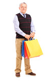 Full length portrait of a gentleman holding shopping bags
