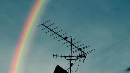 Rainbow, Tv antenna and a crow.