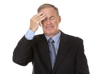 senior businessman having headache