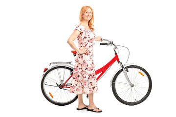 Full length portrait of a mature woman with bicycle