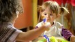 Child helping her friend during meal at school