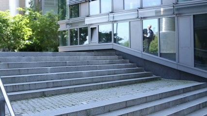 Business people running down stairs