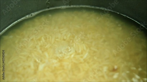 Rice noodles being added to boiling water
