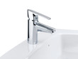 Nice design of the chrome faucet and white washbasin