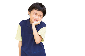 Asian little boy standing with his hand on his mouth suffering f