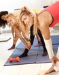 Pretty girls exercising bending