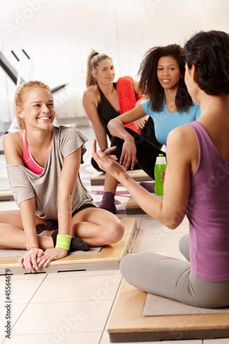 Women talking at the gym after workout