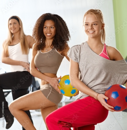 Pretty girls exercising with ball