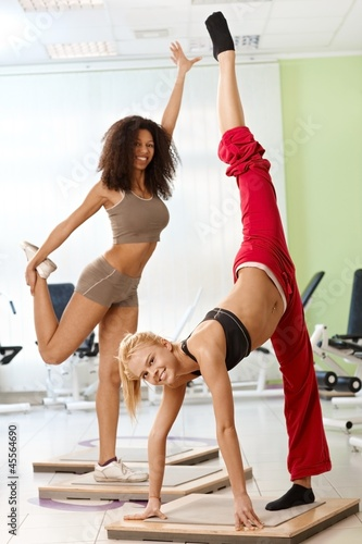 Female gymnasts posing smiling