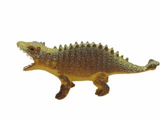 Toy plastic dinosaur isolated on white background