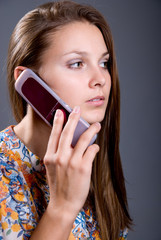 Young woman talking on cell phones
