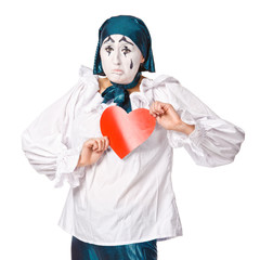 a sad female mime clown with a red heart