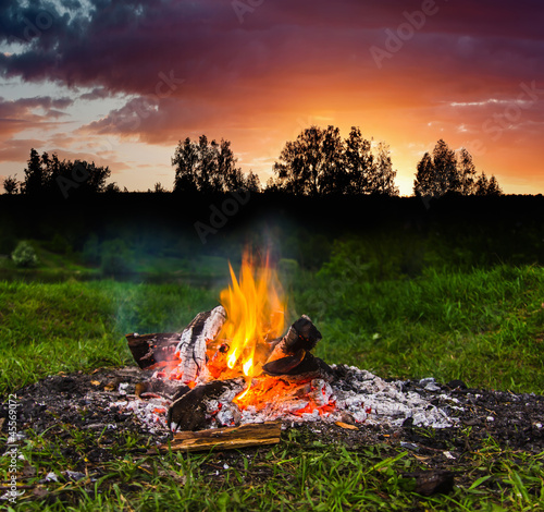 Fireplace in forest at dusk