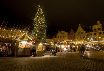 Christmas market around fir tree in Tallinn, Estonia