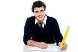 Smiling attractive youngster kid studying poster