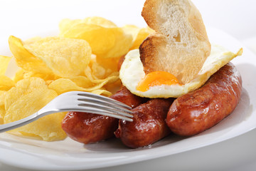 dish fried sausages isolated on white