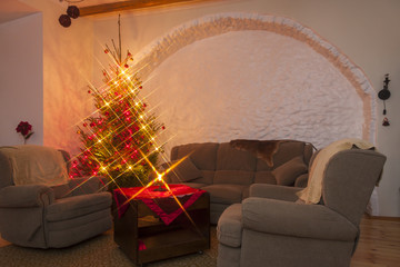 Living room and shiny lighted christmas tree