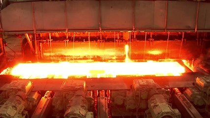 Hot rolled steel. Fresh cast hot metal slab.