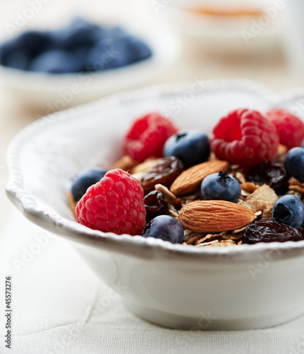 Bowl of granola with fresh fruits and almonds