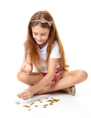 beautiful little girl with coins, isolated on white
