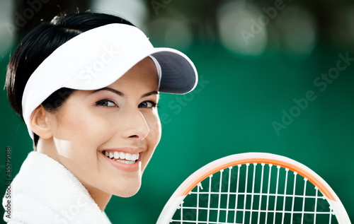 Close up of professional female tennis player with towel