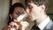 Groom with fiancee drink champagne kiss