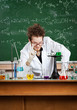 Mad professor makes attention gesture working in his laboratory