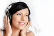 Woman in underwear listens to music through the headphones