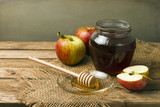 Still life with honey and apples on wooden tabletop poster