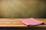 Background with wooden deck tabletop and grunge wall poster