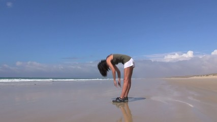attractive woman doing gymnastics on the beach 45