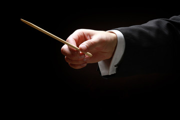 A concert conductor's hands with a baton