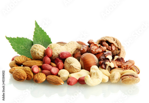 assortment of tasty nuts with leaves, isolated on white © Africa Studio