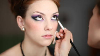 Model making-up for photography in studio.