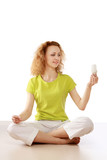 A woman with an energy-saving bulb meditating